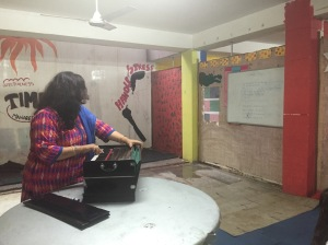 Our voice teacher playing the harmonium